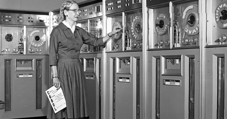 Grace Hopper in front of computer