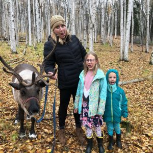 family with a reindeer
