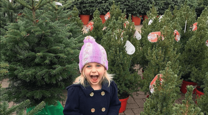 Girl smiling and excited in Christmas Tree lot