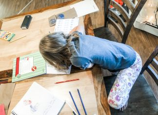 child homeschooling with supplies