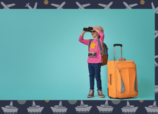 kid with suitcase and binoculars