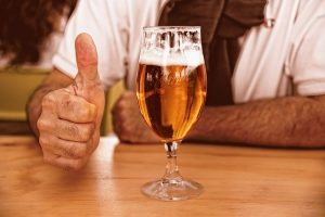 craft beer with a thumbs up