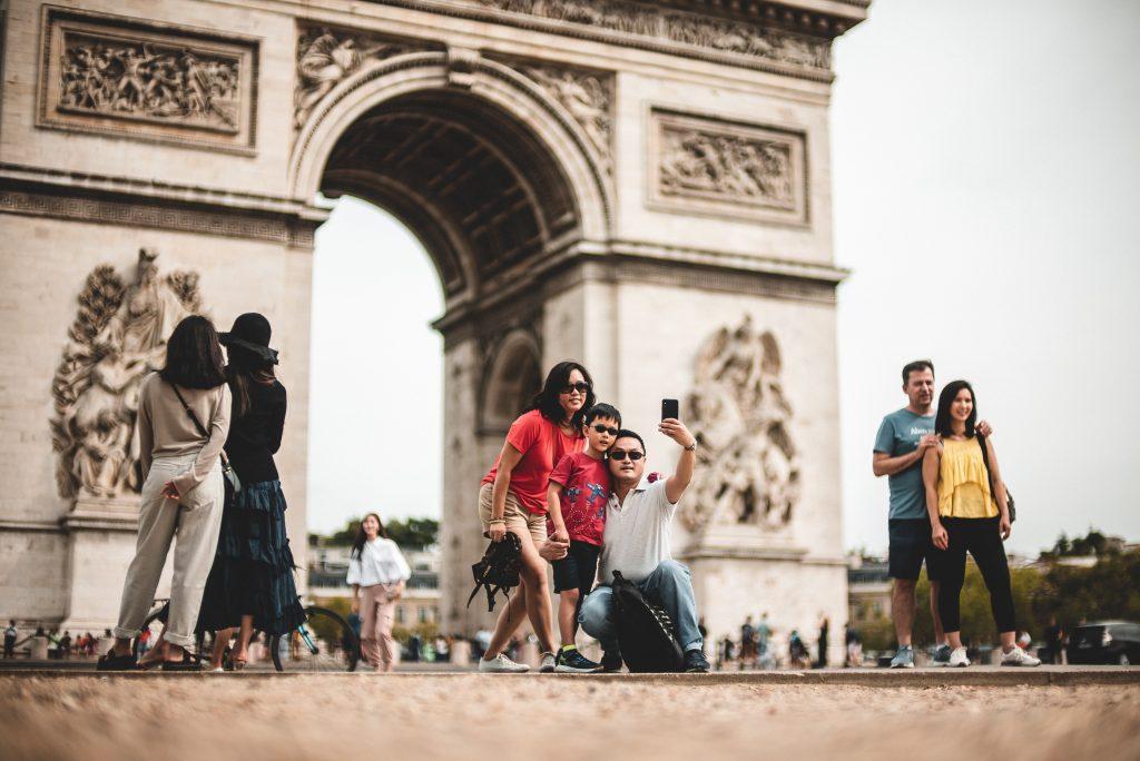 people in front of Arc de Triomphe in Paris