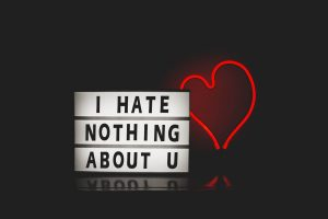 I hate nothing about you on letter board with heart