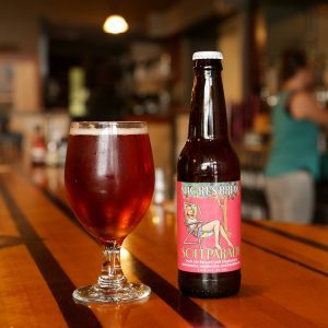 soft parade craft beer bottle and glass
