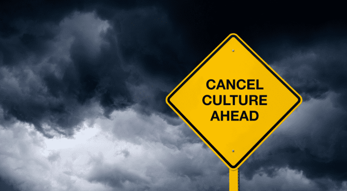 "stormy background with ""Cancel Culture Ahead"" sign"