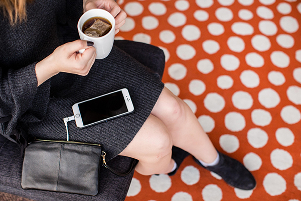 Woman sitting on bench with tea and cute accessories from Wilco Supply
