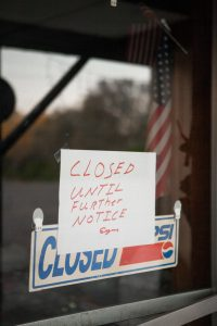 restaurant sign with Closed Until Further Notice on front