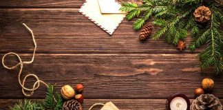 holiday tidings and presents on wood table