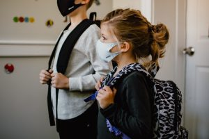 children with masks and backpacks