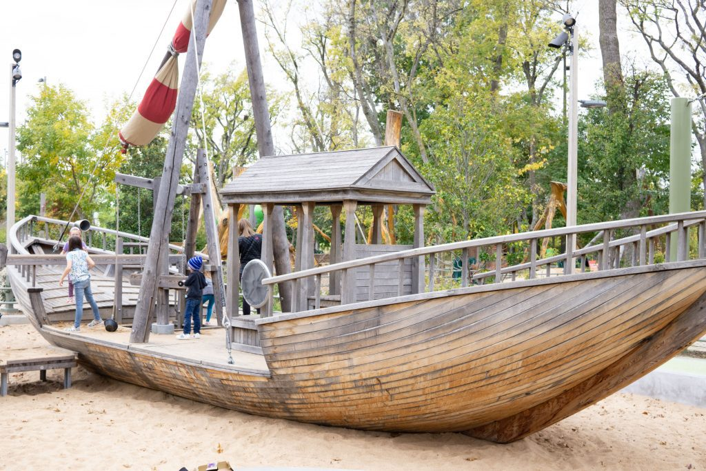 a wooden boat playground