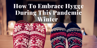 cozy socked feet by fireplace to show hygge