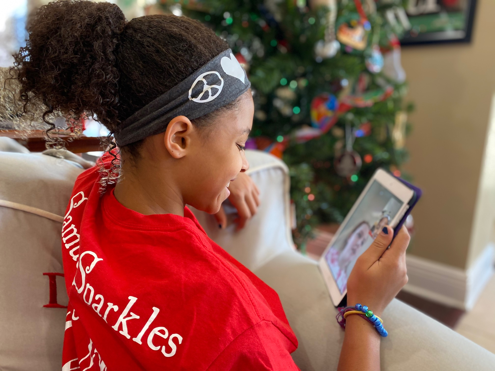 child enjoying app on tablet