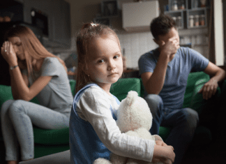 married couple with unhappy child