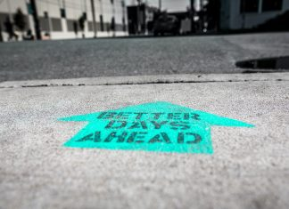 positive arrow on road that reads better days ahead