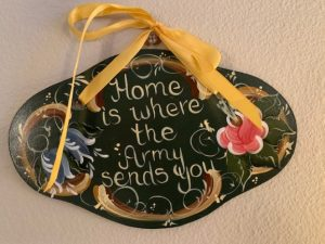 """Sign that reads """"Home is where the Army sends you"""""""