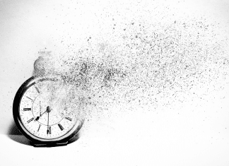 clock disintegrating to symbolize losing time