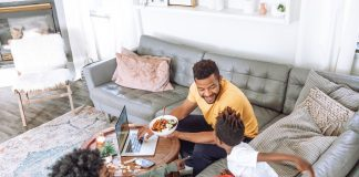 family eating on couch and coffee table