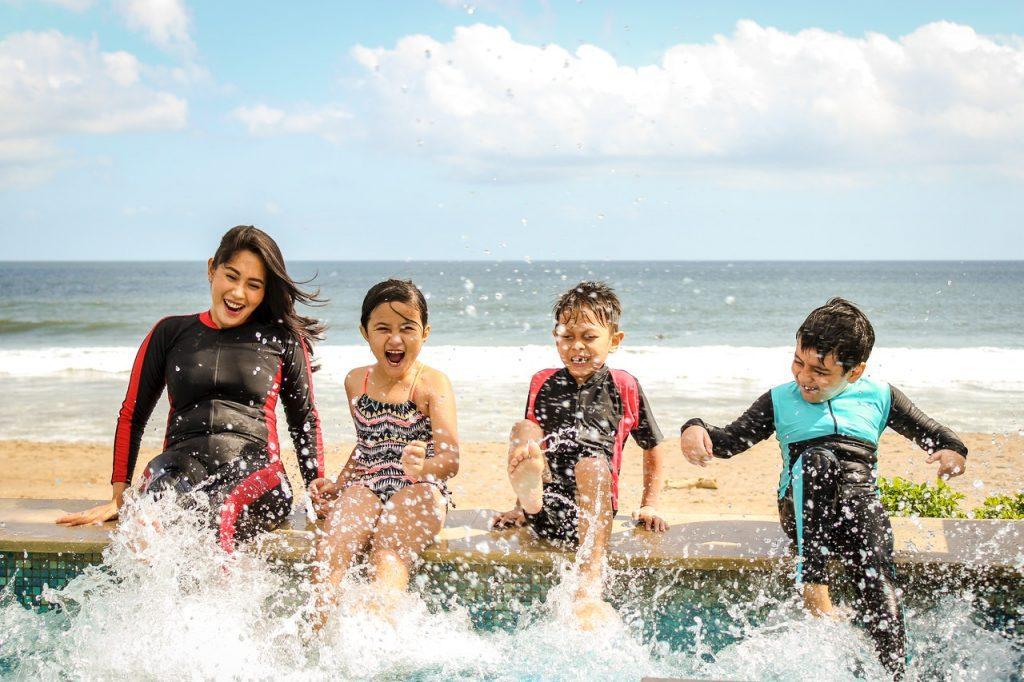 kids splashing on the beach
