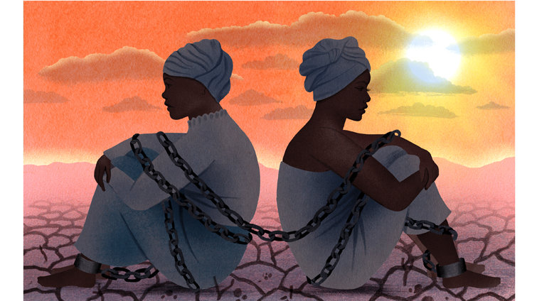 two African women in chains on a dry clay land