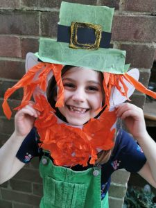 child with homemade leprechaun mask for St. Patrick's Day