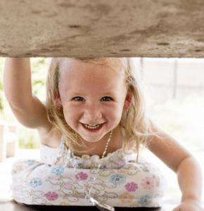 a small girl smiling at the camera