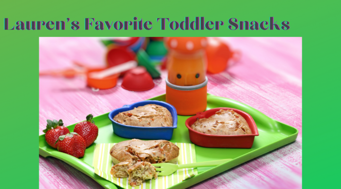 Lauren's Favorite Toddler Snacks with fruit and snacks on a green tray