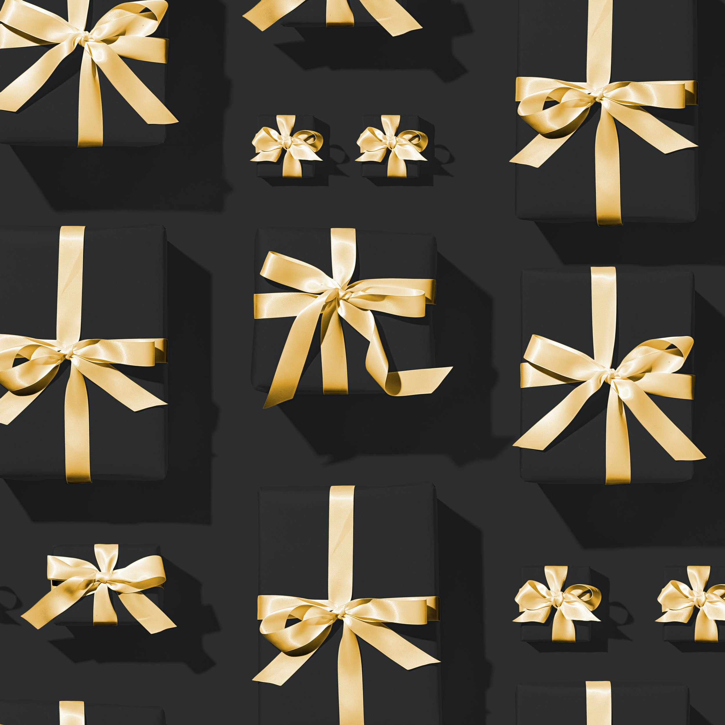 small black gift boxes with gold ribbon
