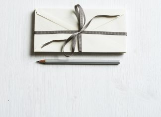 a gift with a bow and a pencil next to it