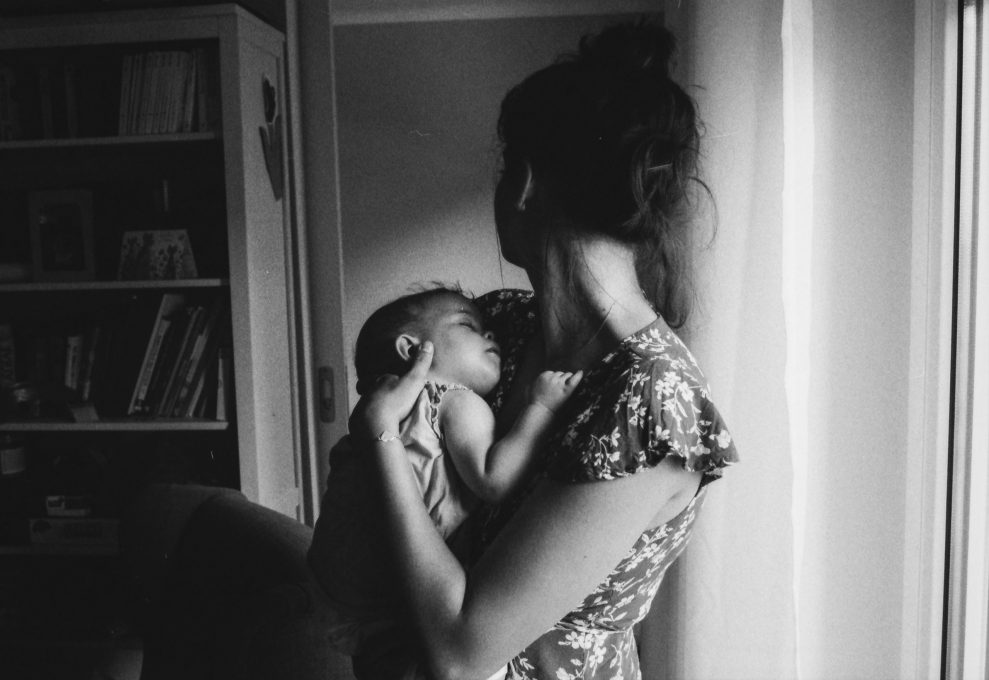black and white photo of mother holding baby