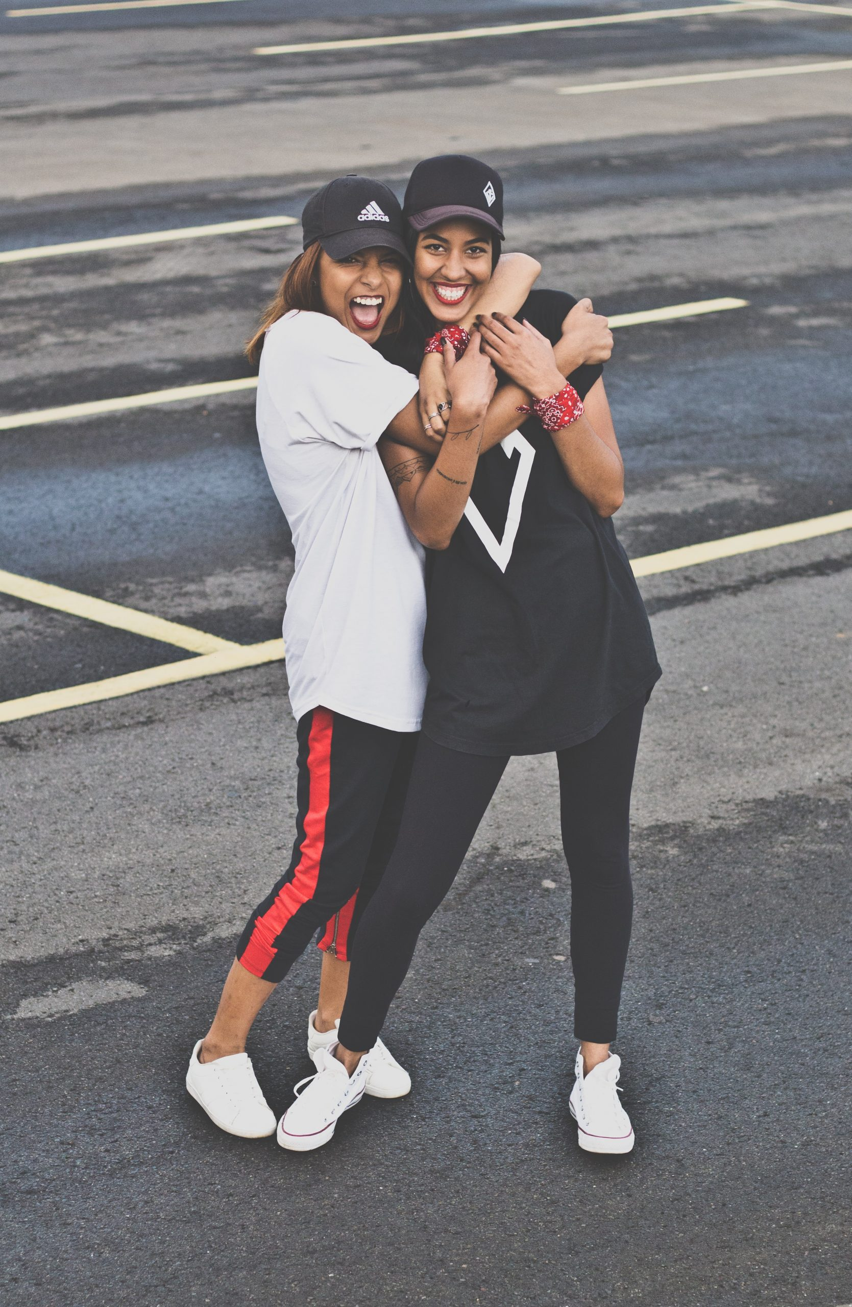 two women standing together in street