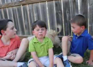 Three boys posing for picture