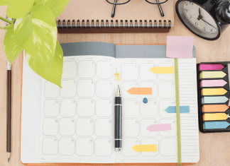 desktop with planner and notes and pens