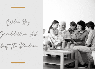 Grandparents and grandchildren sitting together in a black and white photo