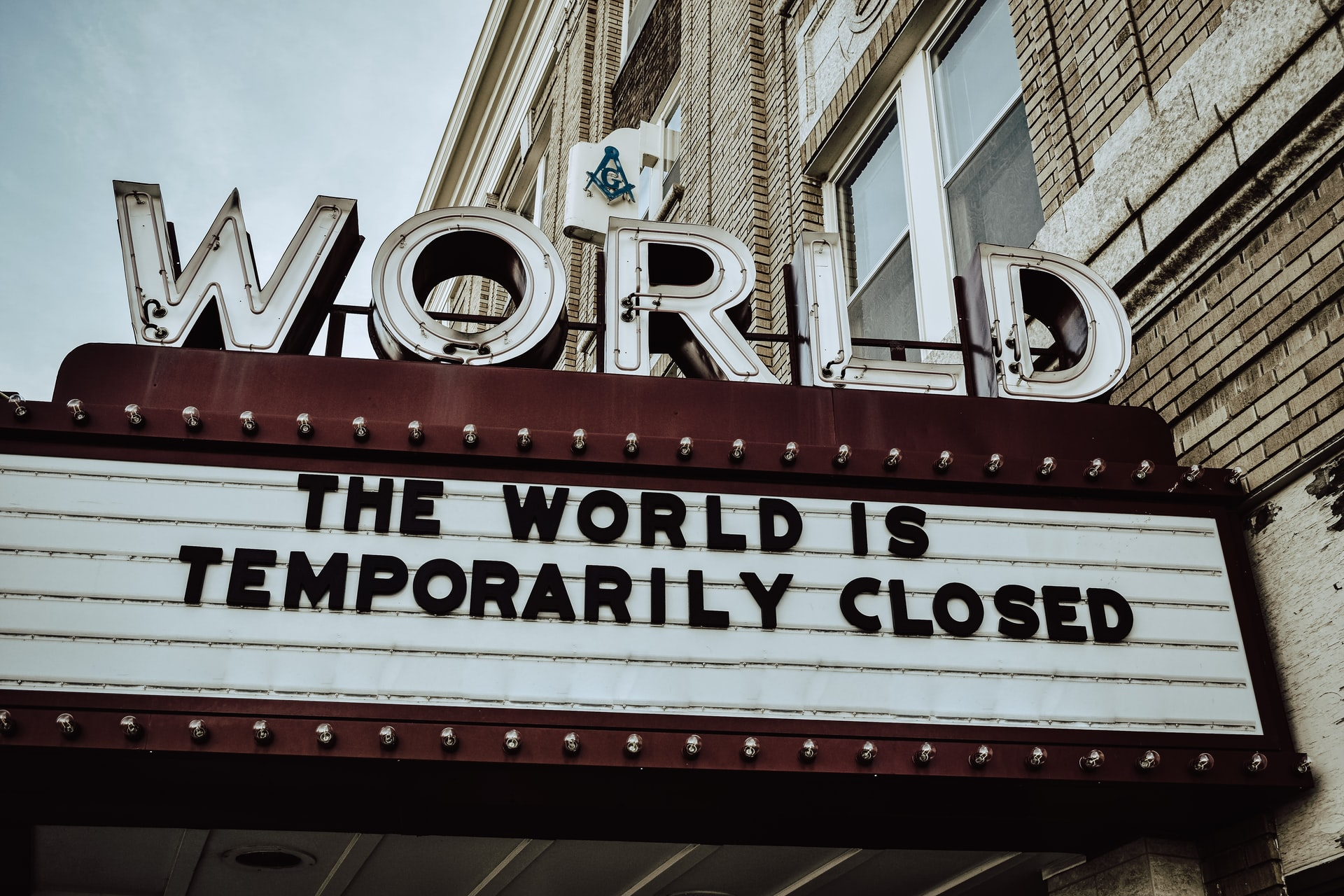 """billboard sign with """"The World Is Temporarily Closed"""""""