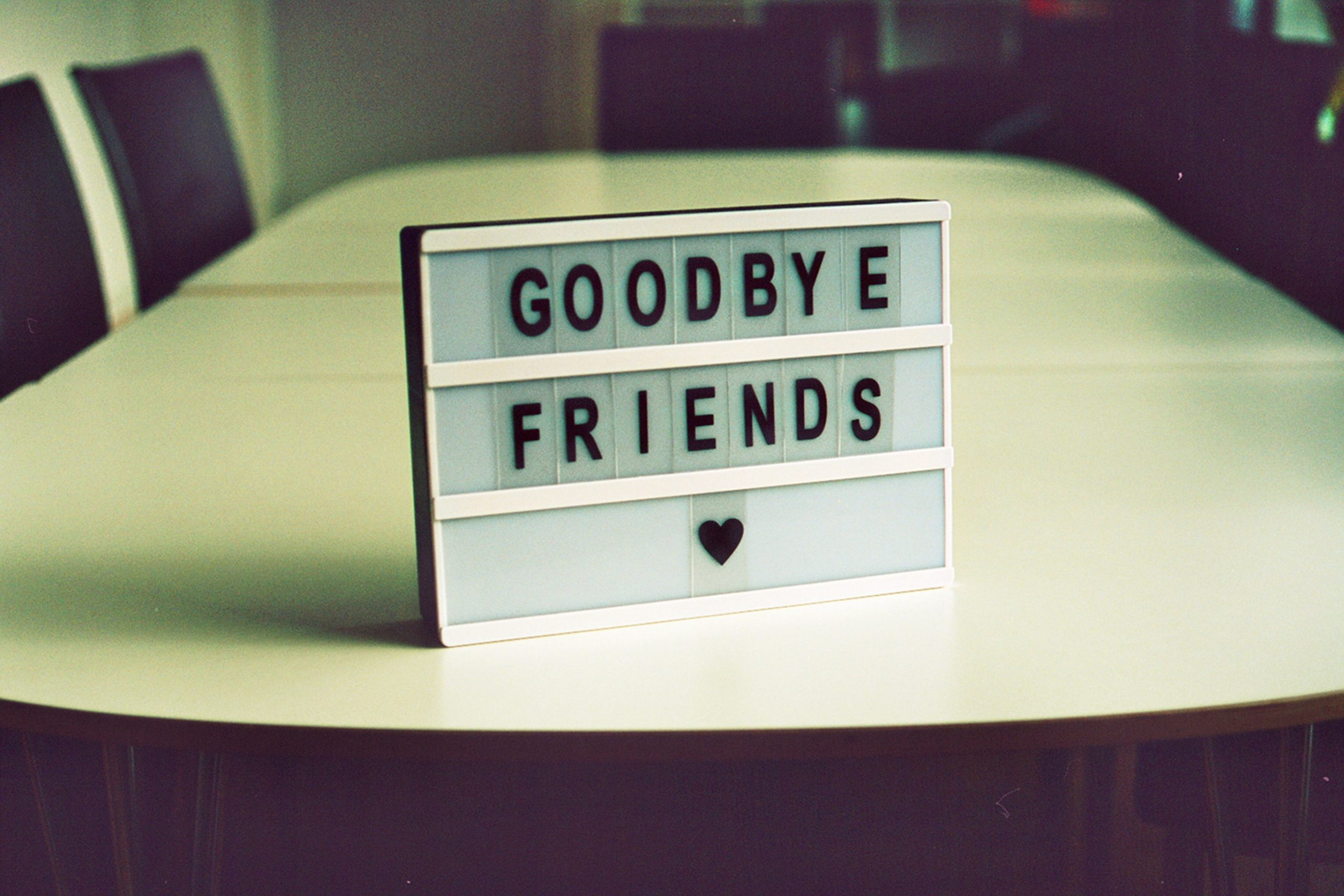 """letter board on table with """"Goodbye Friends"""""""