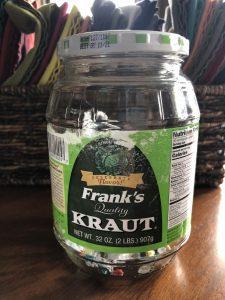 empty sauerkraut jar on a kitchen table