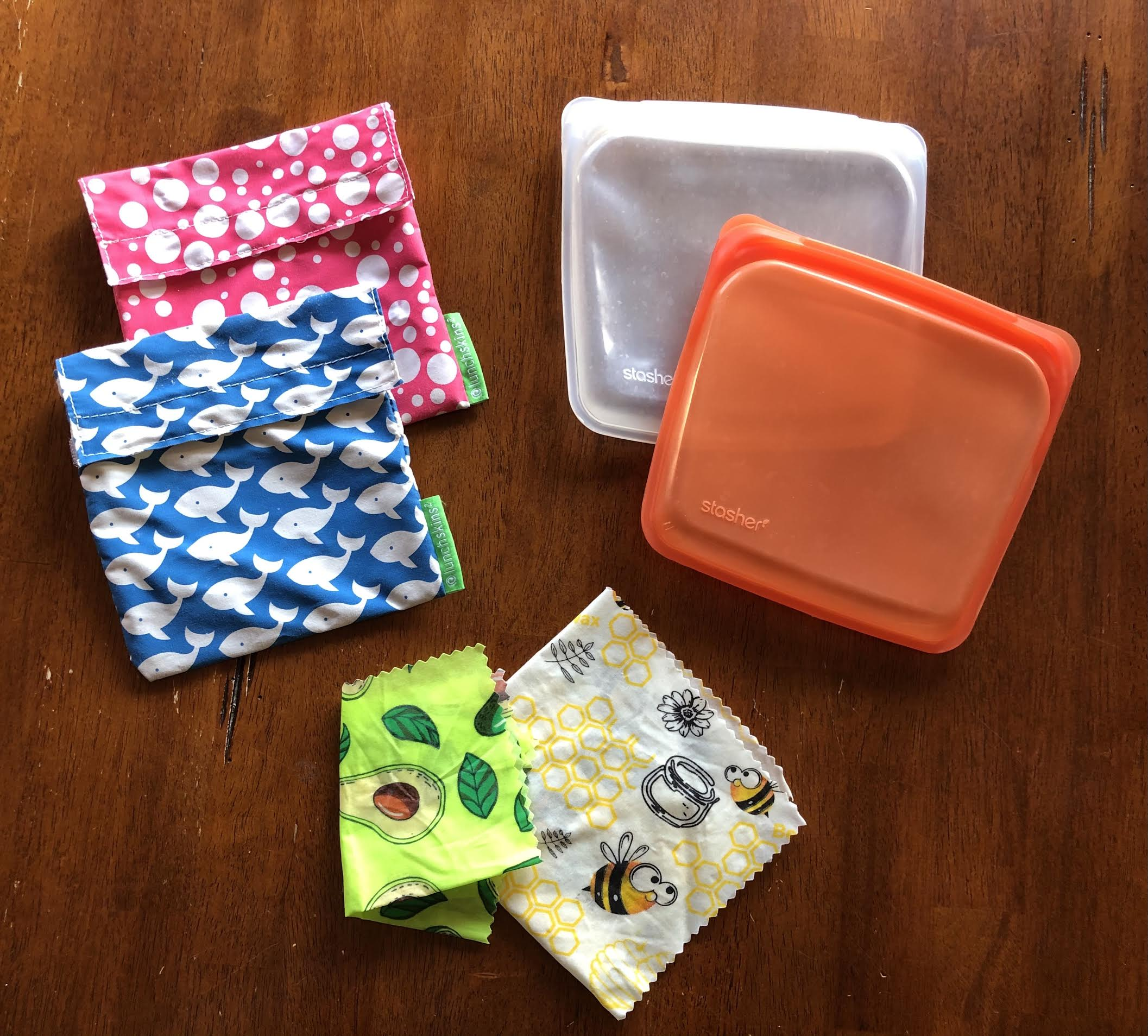 reusable sandwich bags, snack bags, and container covers on a kitchen table