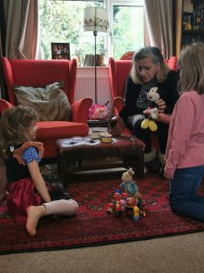 grandmother playing toys with her granddaughters
