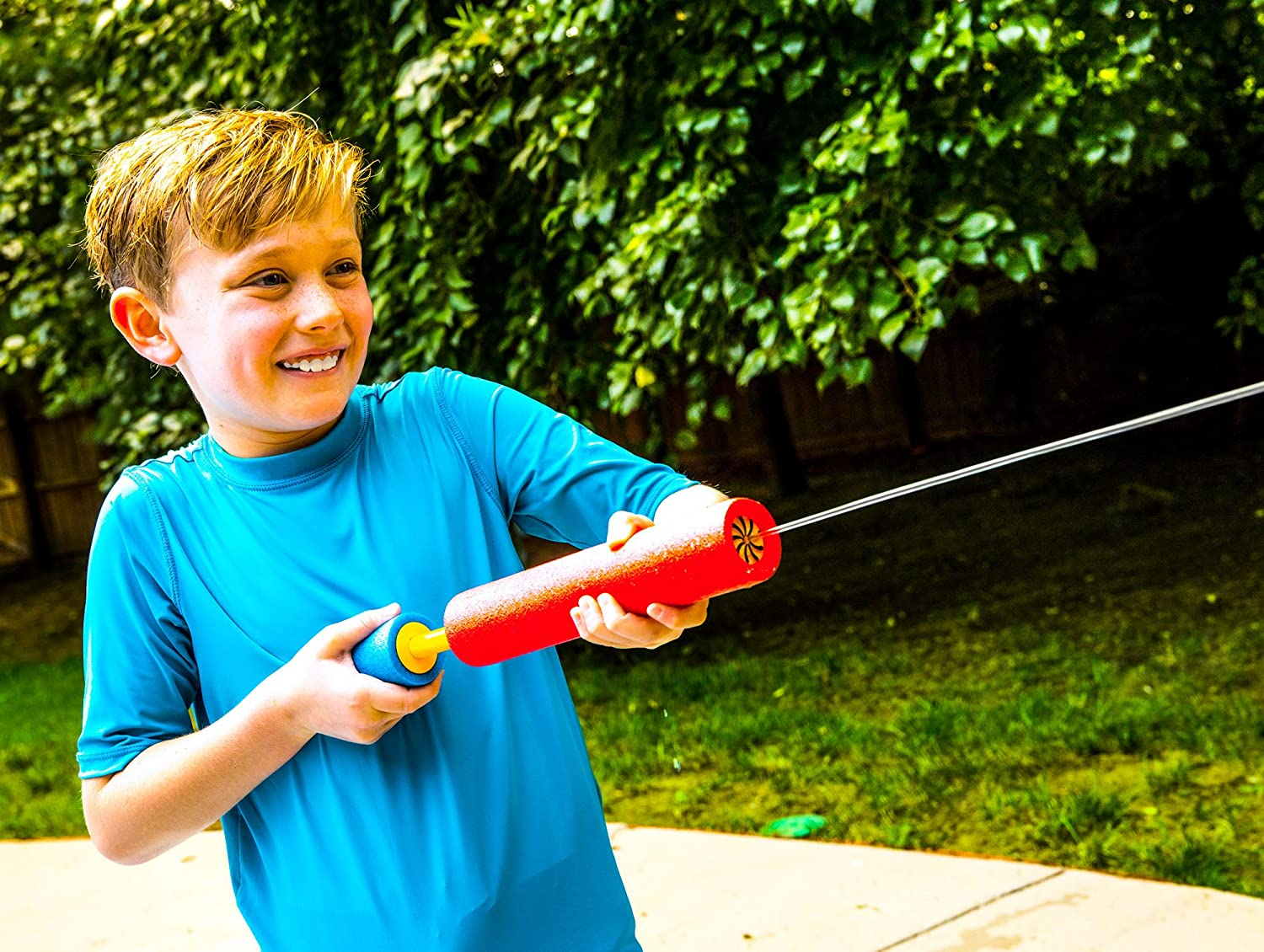 boy squirting water outside with a foam water gun