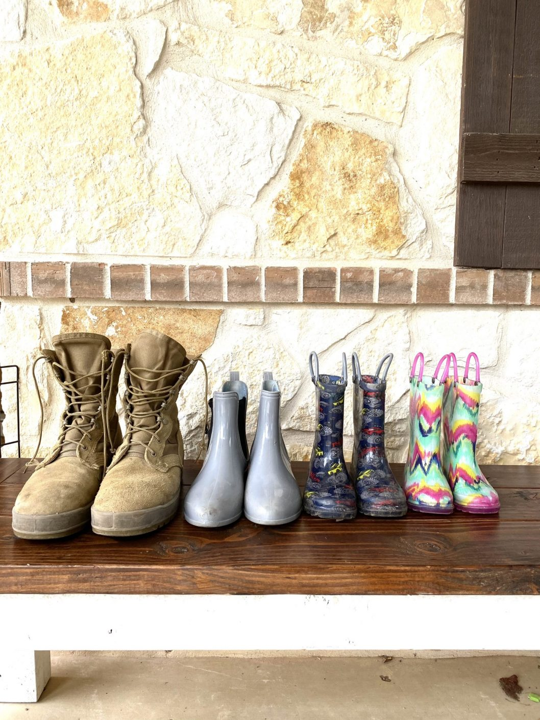 Military boots lined up alongside family boots