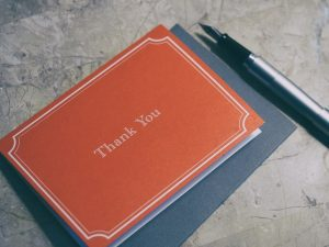 a thank you card with pen
