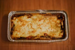 baked pasta in a tinfoil pan