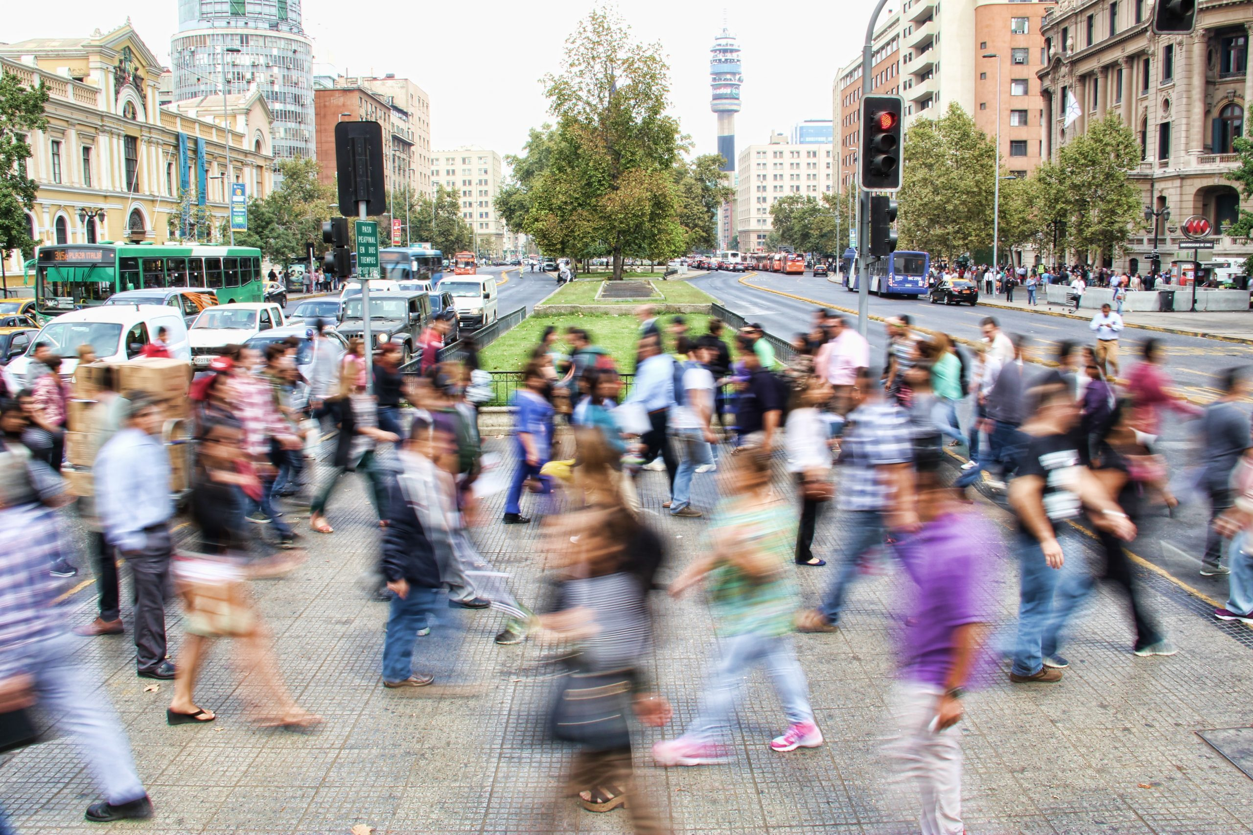 blurred image of people in busy road