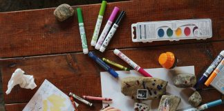 rocks and crayons and markers on a table