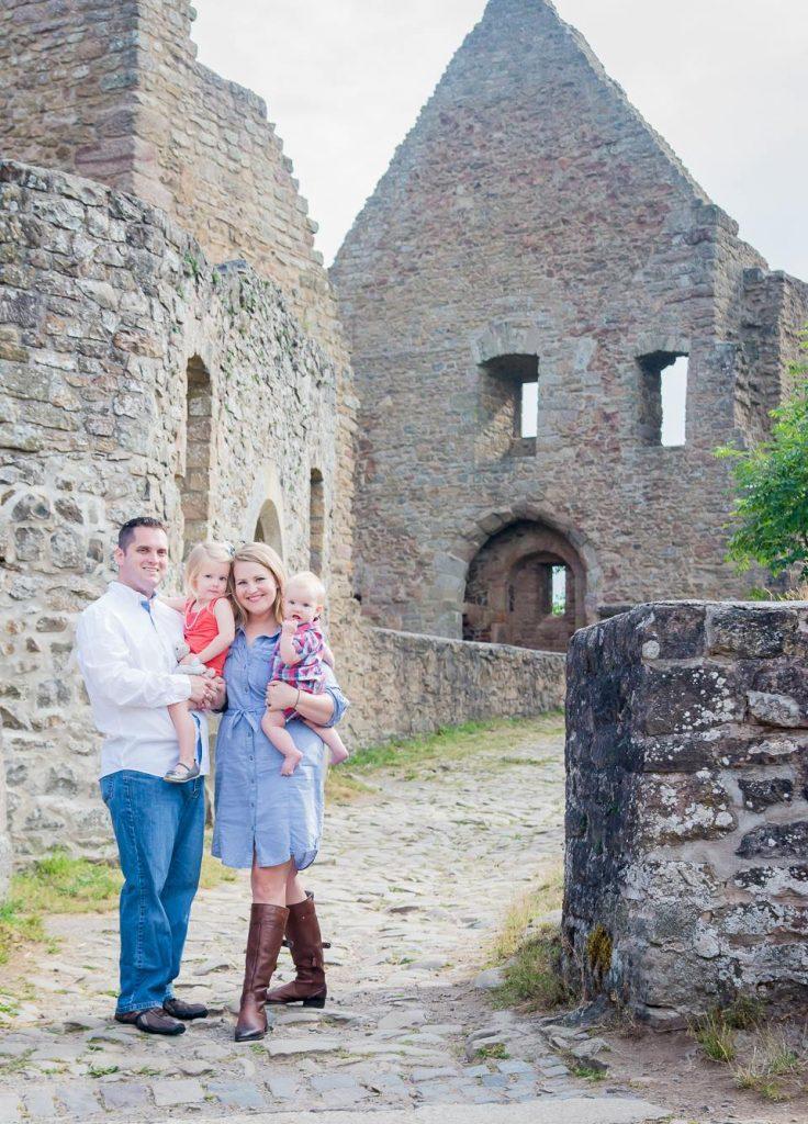 family photo outside a castle