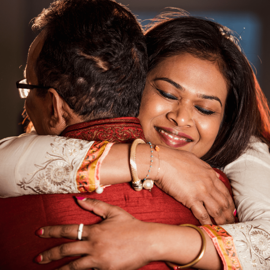 man and woman hugging goodbye