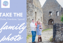 """family photo in front of a castle with MMC logo and """"Take the (Cliche, Overdone, Typical) Family Photo"""" in text"""