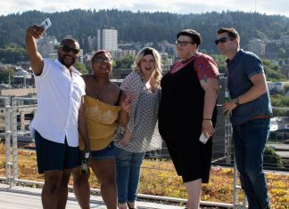 group of adults taking a selfie