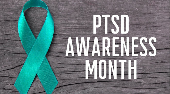 """teal ribbon with """"PTSD Awareness Month"""" in white text"""